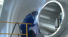 MIG welding on a giant tank pedestal